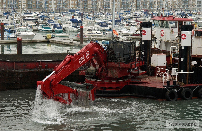 Industrial dredger in harbor