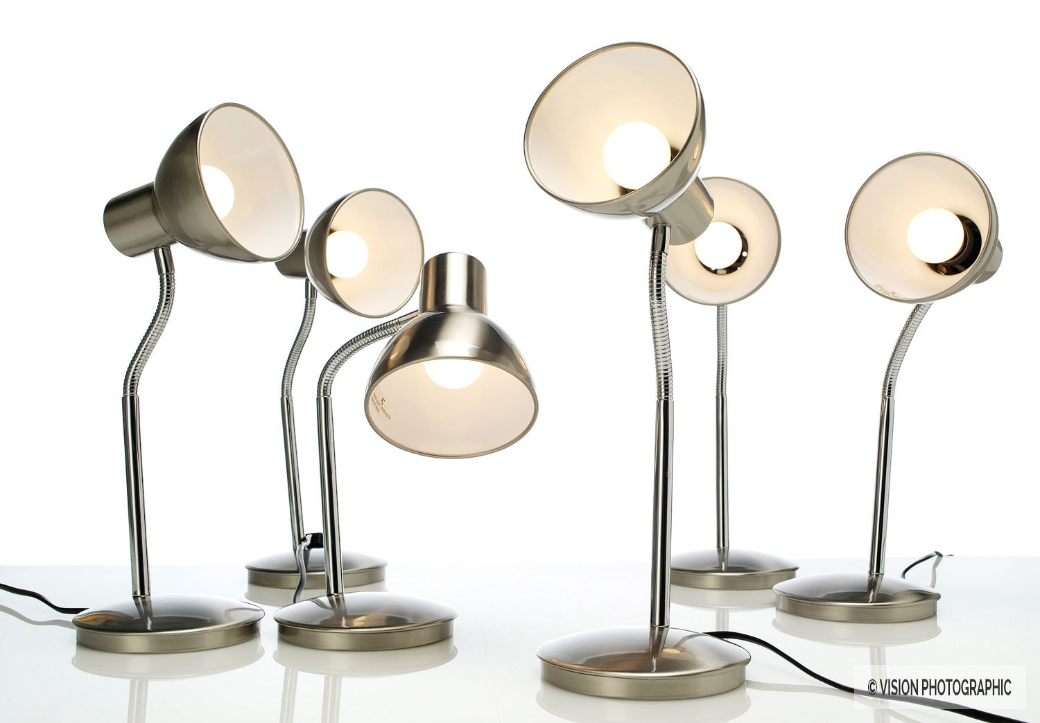 Still life photography of lamps symbolising people laughing at a meeting