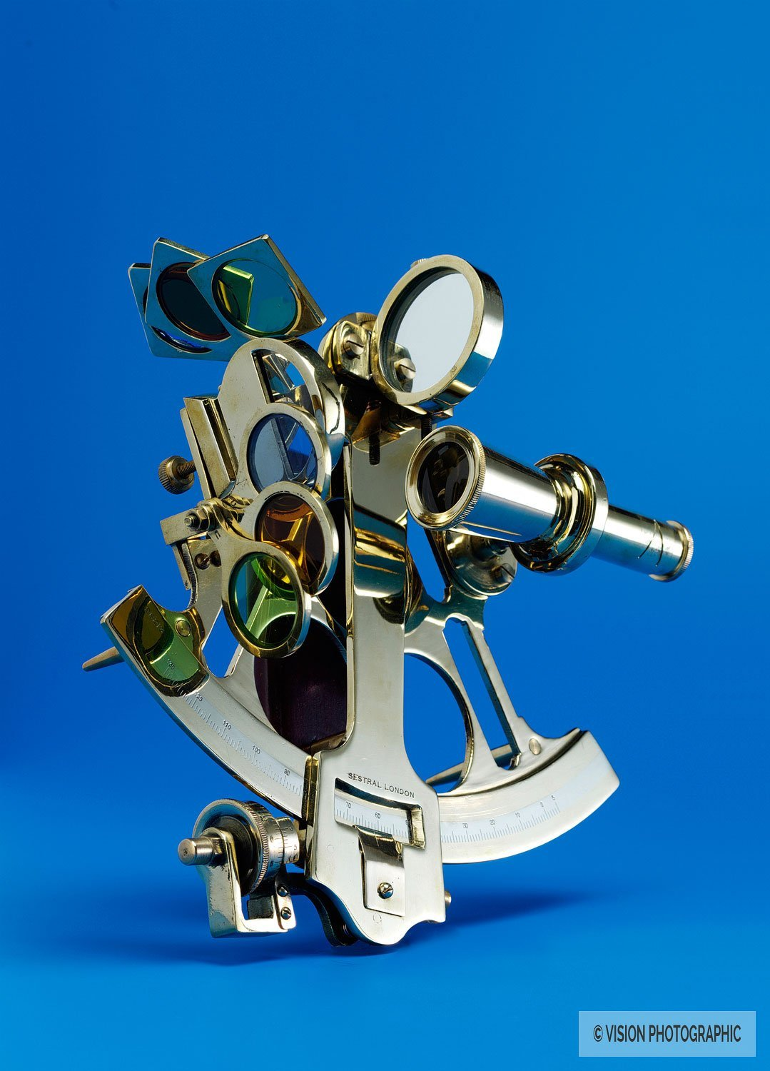 still life image of a golden sextant