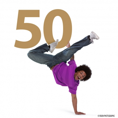 Advertising photography dancer holding a big 50